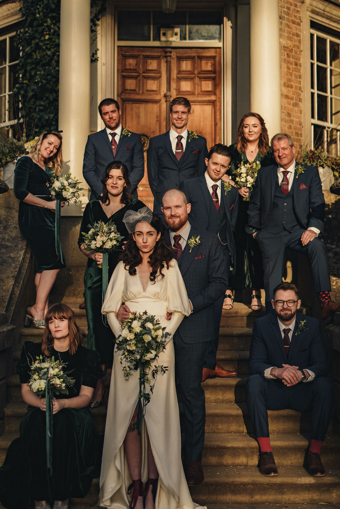 Bridal party portrait on the steps of  Hampton Court House