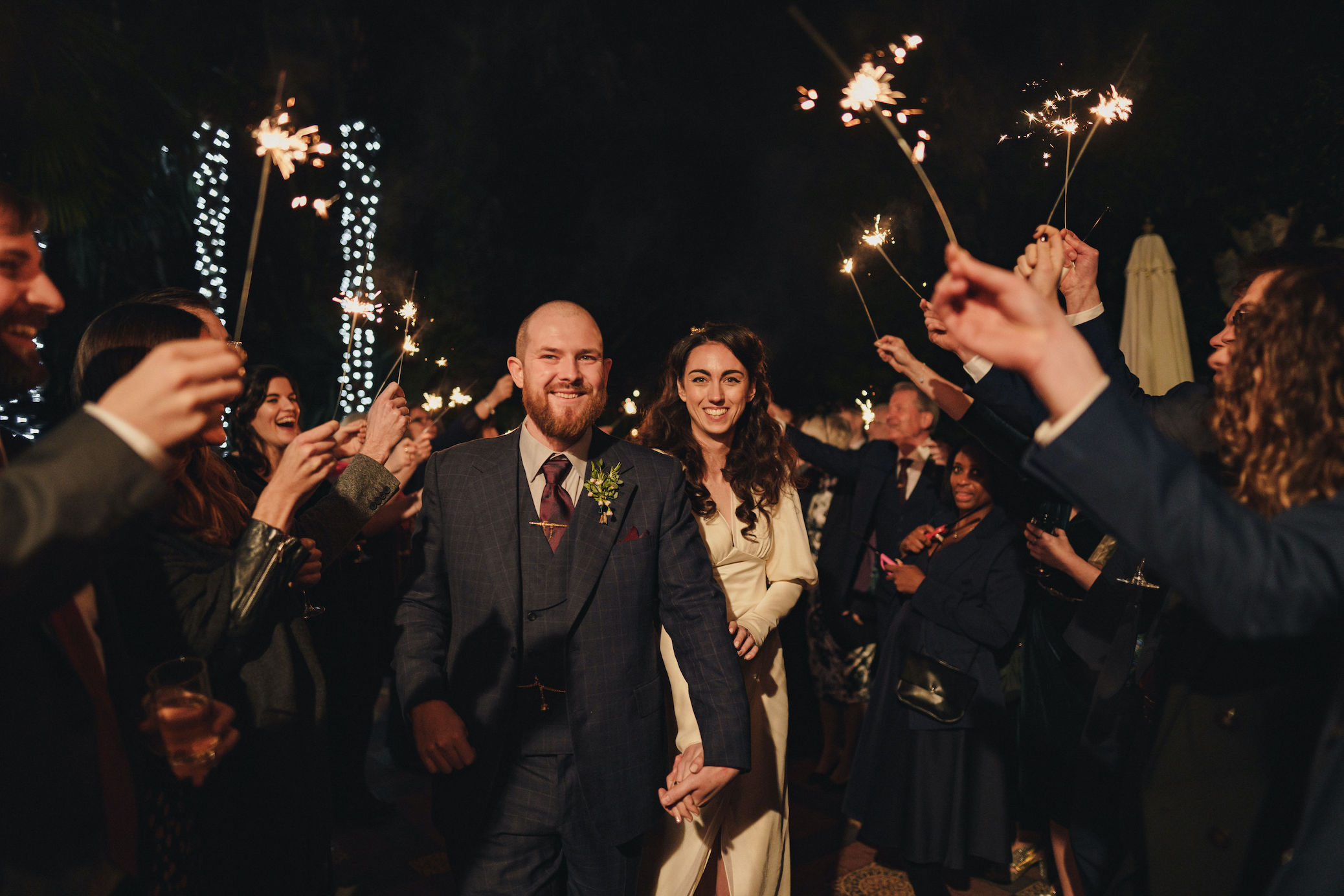 Bride and groom making their exit with sparklers